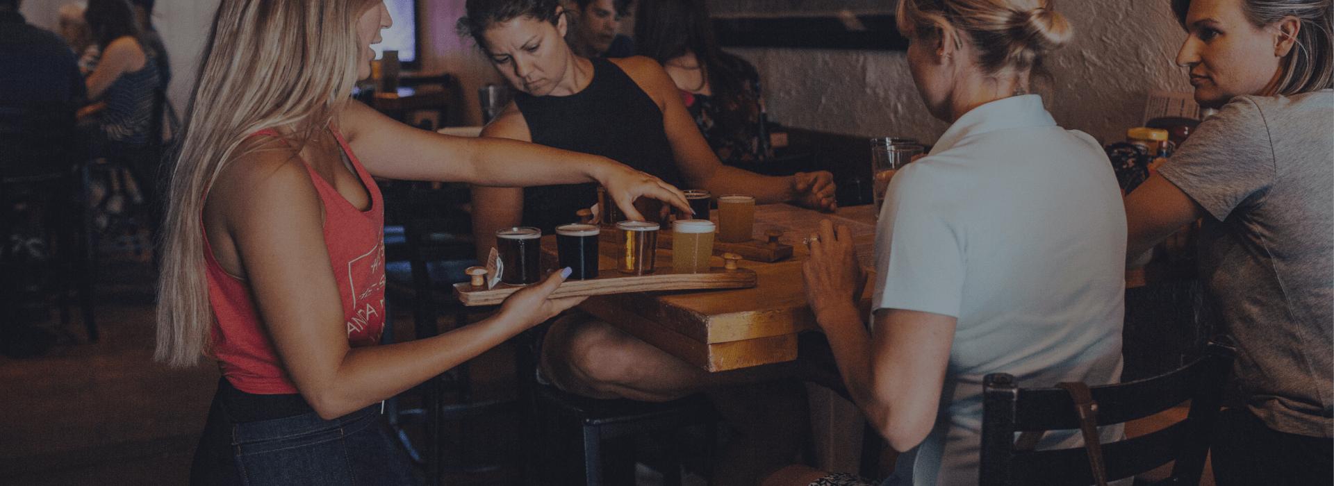Waiter serving beer