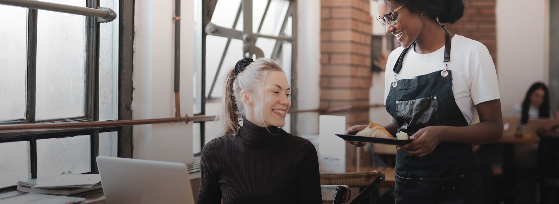Woman and the waitress at the restaurant