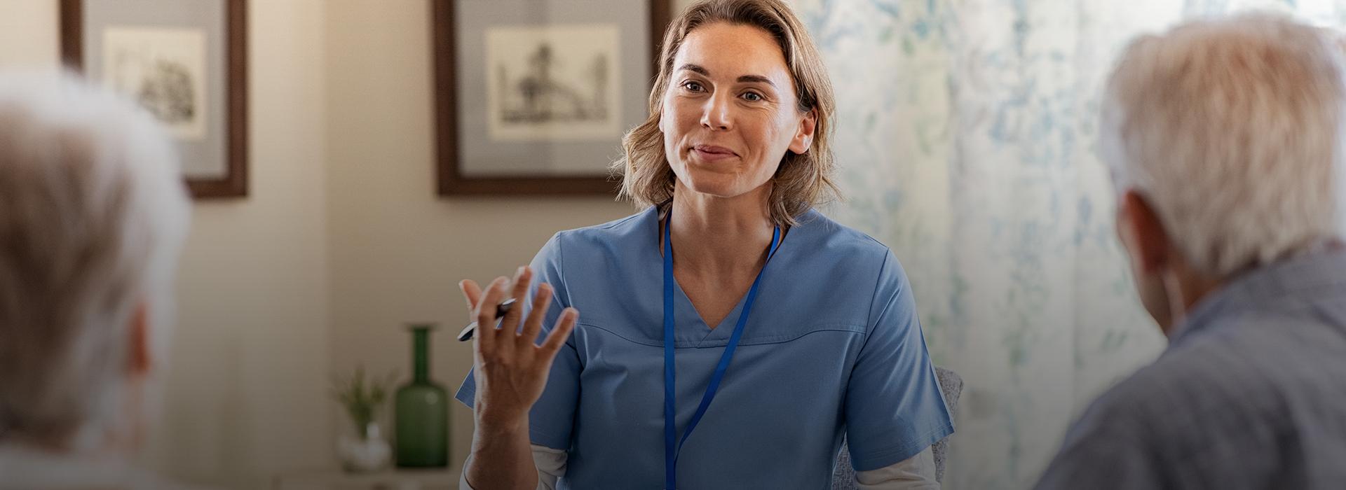 Healthcare worker talking to senior people