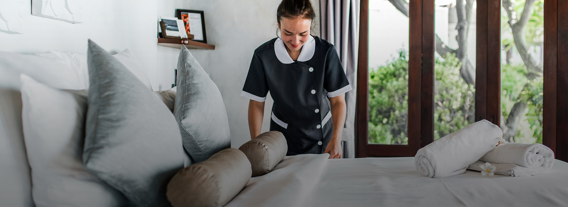The maid makes the bed