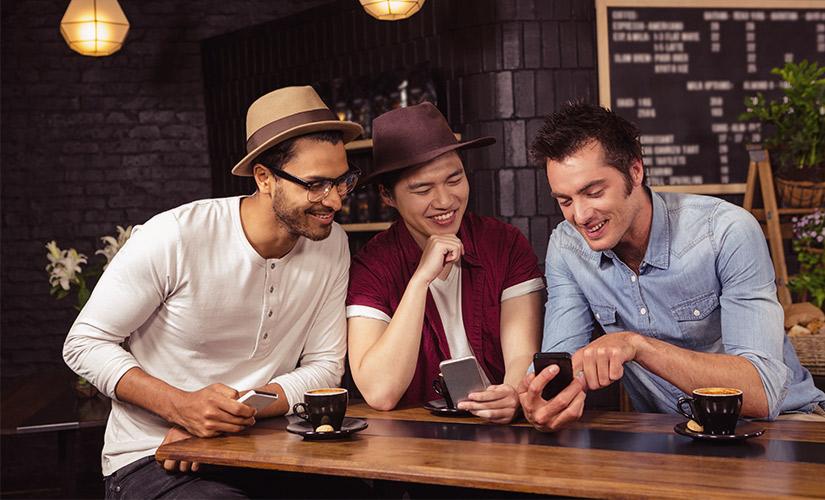 three men at cafe