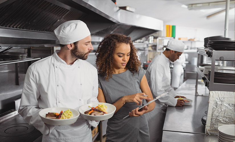 A man and a woman in kitchen